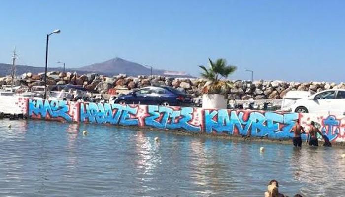 Γκράφιτι στην προβλήτα στις Καλύβες μετά απο...πρόσκληση
